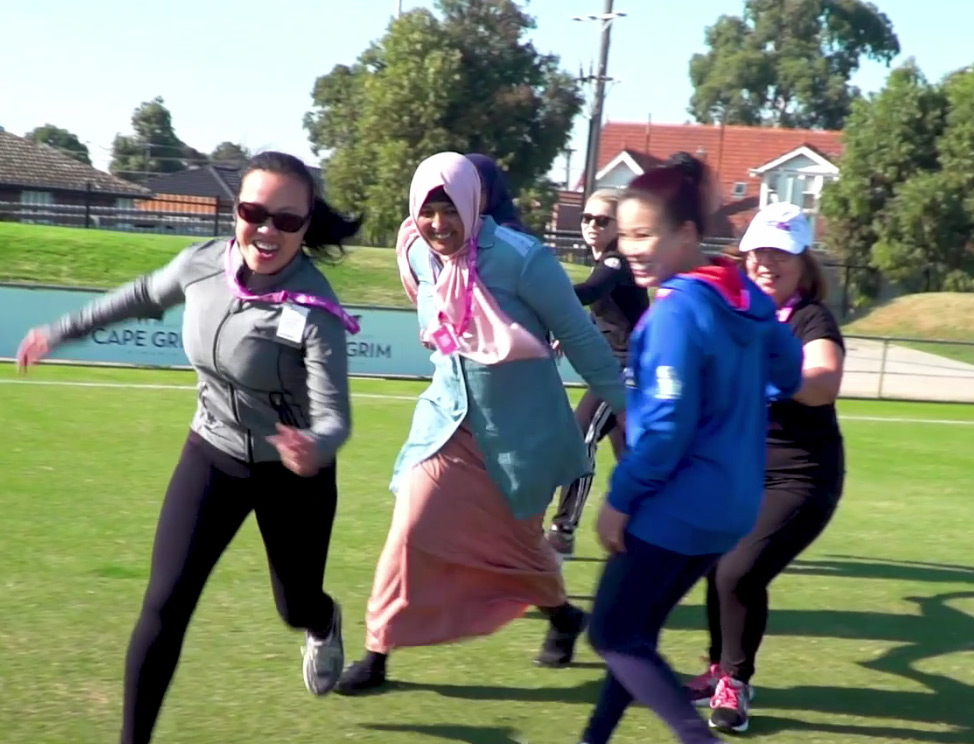 Group of women playing football