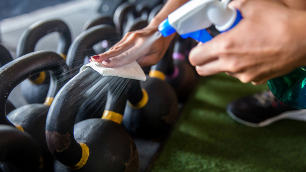 Cleaning dumbbells at a gym